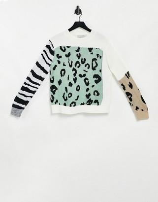Liquorish oversized jumper in mixed animal print