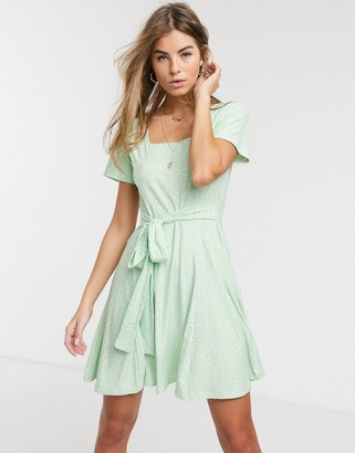 Qed London soft touch square neck mini dress with tie back in mint polka dot