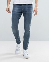 Asos Super Skinny Ankle Grazer Jeans In Mid Wash Blue