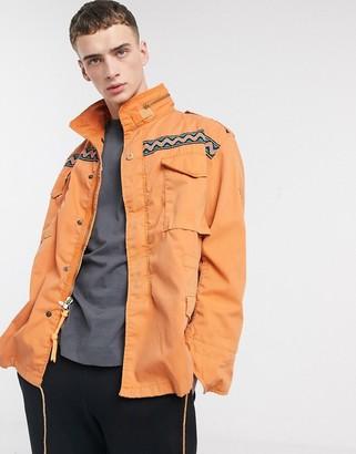 Vintage Supply alpine overdye field jacket in orange