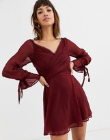 Asos Design DESIGN mini dress with layered skirt and wrap waist with lace trim detail