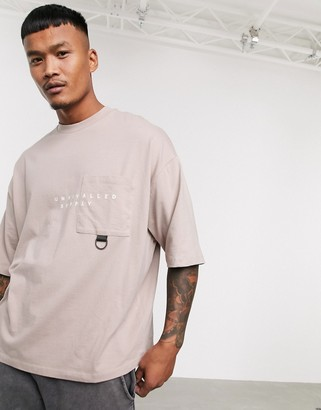 Asos Unrvlld Supply ASOS Unrvlld Spply organic cotton oversized T-shirt with pocket detail and Unrvlld Spply logo
