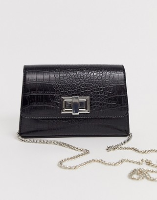 ASOS DESIGN croc cross body bag with twist lock and chain detail