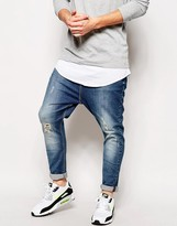 Asos Drop Crotch Jeans With Rip And Repair Detail