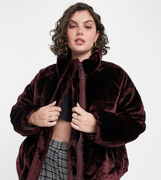 ASOS DESIGN Curve plush faux fur puffer jacket in burgundy