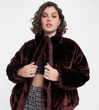 ASOS DESIGN Curve plush faux fur puffer jacket in burgundy