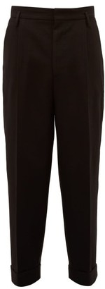 Raey Exaggerated Tapered-leg Wool Trousers - Black