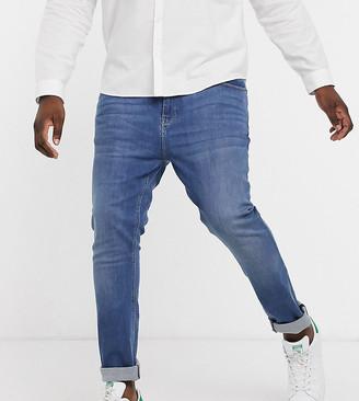 ASOS DESIGN Plus super skinny jeans in mid wash