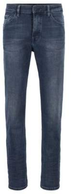 BOSS Relaxed-fit jeans in used-effect dark-blue stretch denim