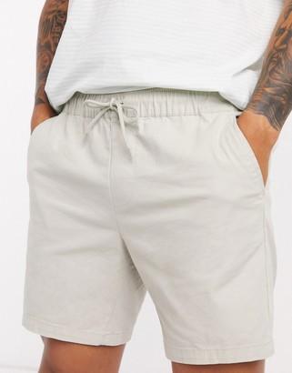 ASOS DESIGN slim chino shorts with elastic waist in beige