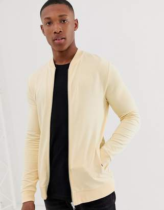 Asos Design DESIGN jersey muscle bomber jacket in light yellow