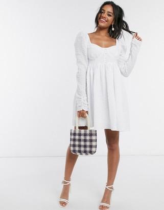 ASOS DESIGN mini babydoll dress in texture in white