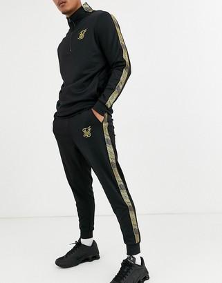 SikSilk skinny sweatpants in black with gold logo