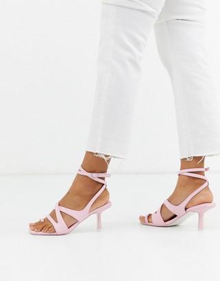 Asos Design DESIGN Harley strappy toe loop mid-heeled sandals in pale pink