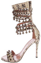 Alaia Snakeskin Bell-Embellished Sandals