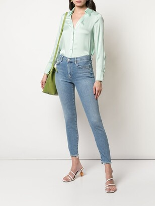 A Gold E Agolde acid wash cropped jeans