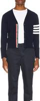Thom Browne Cashmere Cardigan with Bar Stripe Sleeve in Navy   FWRD