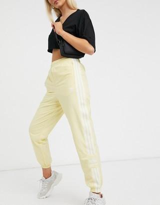adidas adicolor track pants in yellow