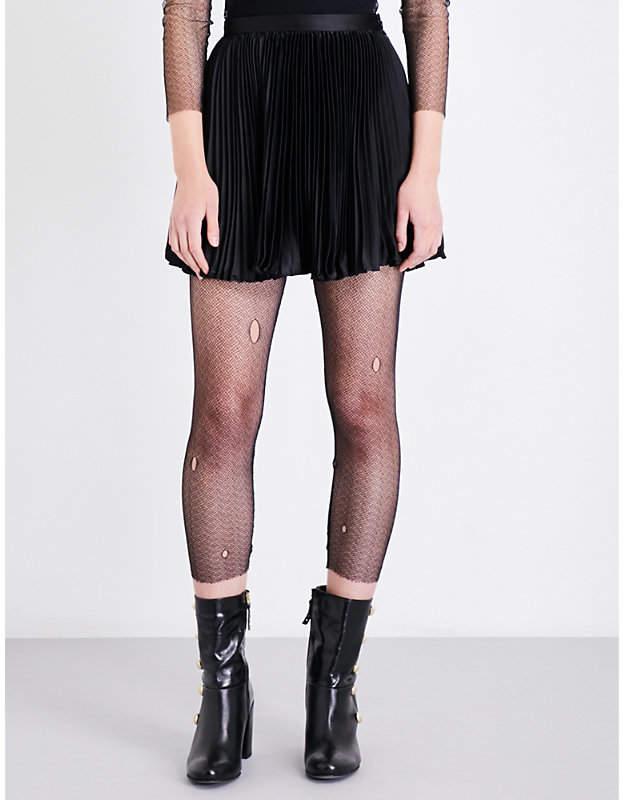 Anna Sui Distressed fishnet leggings