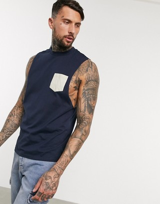 ASOS DESIGN organic relaxed sleeveless t-shirt with dropped armhole and contrast pocket in navy