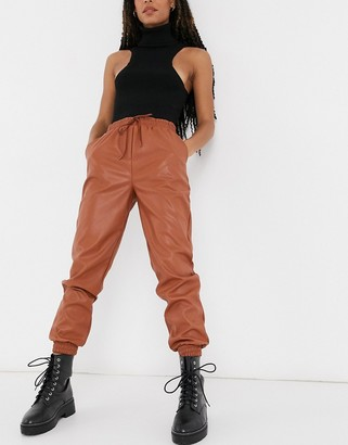 New Look leather look sweatpants in rust