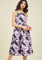 D-61190 Your taste is well-cultivated, meaning you're a gal that knows just what she wants in a fancy frock. Enter this black fit and flare, and its ModCloth-exclusive design of luxe, lavender florals, aqua accents, side pockets, and pretty pleats speak to