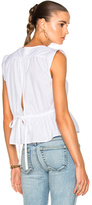 Frame Sleeveless Peplum Blouse in White.