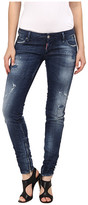 gwen stefani  Who made Gwen Stefanis black strappy sandals, silver clutch handbag, and blue jeans?