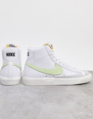 Nike Blazer Mid 77 trainers in white and fluro green