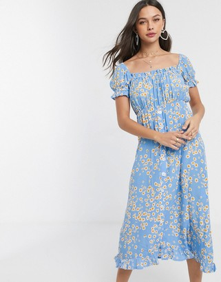 Faithfull The Brand Faithfull ina floral short sleeve midi dress with button front in blue