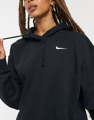 Nike mini swoosh oversized hoodie in black