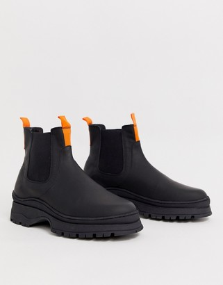 Asos Design DESIGN chelsea sneaker boots in black leather with chunky sole