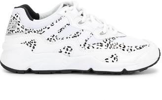 New Balance 850 leopard print sneakers