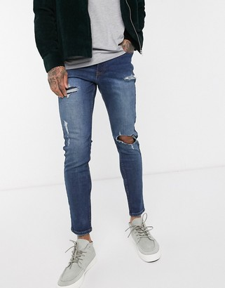 New Look rip and repair skinny jeans in mid wash