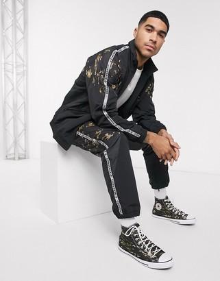 Converse ERX camo paneled cuffed sweatpants in black
