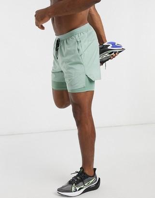 Nike Flex Stride 2in1 5inch shorts in sage green