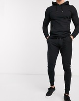 Asos Design DESIGN muscle tracksuit with hoodie & extreme super skinny sweatpants in black