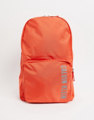 Calvin Klein logo backpack in hot coral