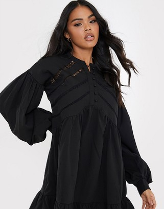 In The Style x Lorna Luxe volume sleeve button front mini smock dress in black