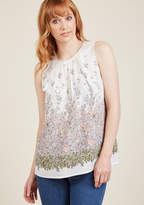 FD87772 Your allure doesn't end with your demeanor - you make your grace known with the addition of this ivory tank top! Detailed with pleating at the neckline, a buttoned back keyhole, and a leafy garden full of pastel pink and purple blooms, this lightweight bl