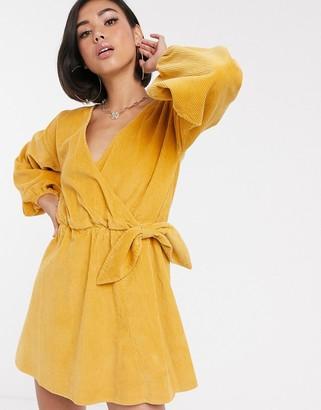 Asos Design DESIGN cord wrap smock mini dress in marigold