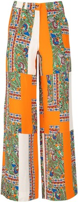 Tory Burch Palazzo Mixed Print Wide-Leg Trousers Pant Realized In Crepe De Chine Enriched By Peculiar Print On The Entire Surface Belt Loops At The Waist Concealed Zip Closure And Single Visible Button Slant Pockets Two Patch Pockets At The Bac