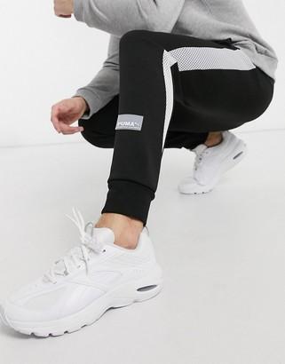 Puma Evide logo sweatpants in black