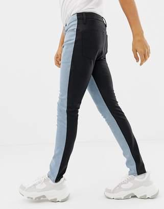Asos Design DESIGN super skinny jeans in vintage light wash with contrast PU back-Blue