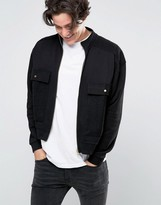 Asos Oversized Funnel Neck Jersey Bomber With Reverse Loopback Pockets