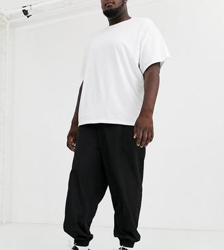 ASOS Plus tapered joggers in black nylon