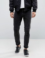 Asos Skinny Black Jeans With Rips And Stitching In Black
