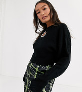 Collusion COLLUSION cropped sweater in waffle knit with cut out detail in black