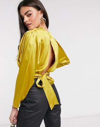 Flounce London gathered satin top with shoulder pads and cut out back in chartreuse