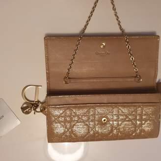Christian Dior Gold Cloth Clutch bags